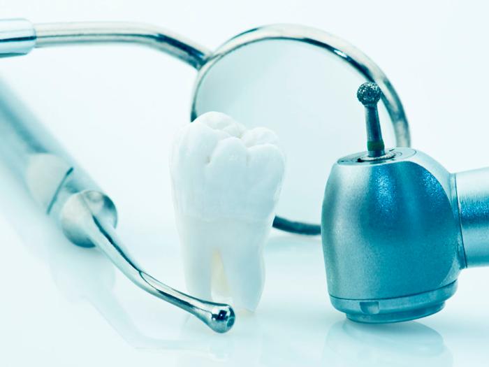 Как происходит удаление зубов