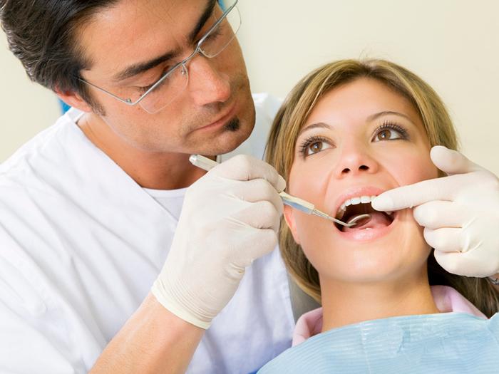 Что делать с болью после удаления зуба